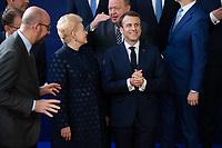 Le Pr&eacute;sident fran&ccedil;ais Emmanuel Macron et Dalia Grybauskaitė Pr&eacute;sidente de la R&eacute;publique de Lituanie lors de la photo de famille au Sommet europ&eacute;en &agrave; Bruxelles.<br /> Belgique, Bruxelles, 22 mars 2019 <br /> Lithuanian President Dalia Grybauskaite, left, and French President Emmanuel Macron talk as they pose for a family photo during the European Union summit.<br /> Belgium, Brussels, 22 March 2019.