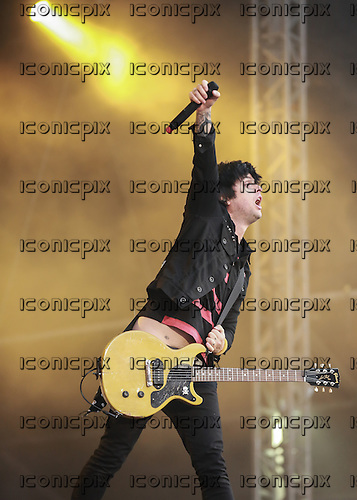 GREEN DAY - vocalist and guitarist Billie Joe Armstrong - performing live on the 99 Revolutions Tour at a  sold out concert at the Emirates Stadium in London UK - 01 June 2013.  Photo credit: Iain Reid/IconicPix