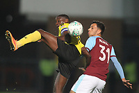 Burnley's Dwight McNeil battles with Burton Albion's Lucas Atkins<br /> <br /> Photographer Mick Walker/CameraSport<br /> <br /> The Carabao Cup Round Three   - Burton Albion  v Burnley - Tuesday  25 September 2018 - Pirelli Stadium - Buron On Trent<br /> <br /> World Copyright © 2018 CameraSport. All rights reserved. 43 Linden Ave. Countesthorpe. Leicester. England. LE8 5PG - Tel: +44 (0) 116 277 4147 - admin@camerasport.com - www.camerasport.com