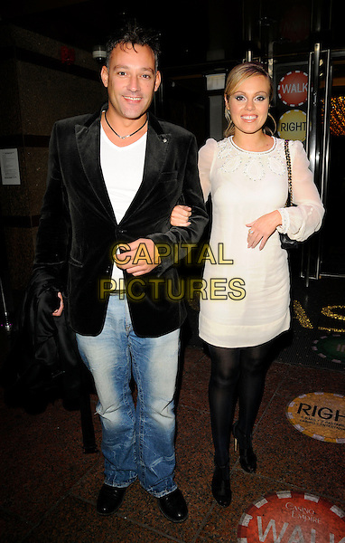 "TOBY ANSTIS & MICHELLE DEWBERRY.""Tropic Thunder"" UK film premiere afterparty, Empire Casino, Leicester Square, London, England..September 16th, 2008.after party dizzy full length jeans denim black suit jacket white cream dress tights .CAP/CAN.©Can Nguyen/Capital Pictures."