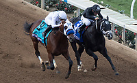 DEL MAR, CA - NOVEMBER 03: Battle of Midway #9, ridden by Flavien Prat, and Sharp Azteca #3, ridden by Paco Lopez, battle for the lead on Day 1 of the 2017 Breeders' Cup World Championships at Del Mar Thoroughbred Club on November 3, 2017 in Del Mar, California. (Photo by Ting Shen/Eclipse Sportswire/Breeders Cup)