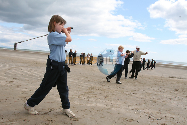 Professional from Laytown and Bettystown Golf Club, Bobby Brown helps Lauren Burberry and her 4th Class classmates with their golf swings when Scoil an Spioraid Naoimh raise the Active Week Flag 2009...Photo NEWSFILE/Jenny Matthews.(Photo credit should read Jenny Matthews/NEWSFILE)....This Picture has been sent you under the condtions enclosed by:.Newsfile Ltd..The Studio,.Millmount Abbey,.Drogheda,.Co Meath..Ireland..Tel: +353(0)41-9871240.Fax: +353(0)41-9871260.GSM: +353(0)86-2500958.email: pictures@newsfile.ie.www.newsfile.ie.FTP: 193.120.102.198.
