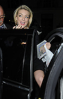 """SHERIDAN SMITH .Departed after the first preview performance of """"Flare Path"""", Haymarket, London, England, UK, 4th March 2011..half length getting into car black holding video case .CAP/CAN.©Can Nguyen/Capital Pictures."""
