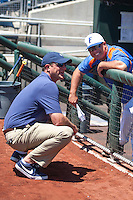 ESPN reported Kyle Peterson talks with Florida Gators Head Coach Kevin O'Sullivan is interviewed before Game 11 of the NCAA College World Series on June 19, 2015 at TD Ameritrade Park in Omaha, Nebraska. The Gators defeated Virginia 10-5. (Andrew Woolley/Four Seam Images)