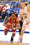 BROOKINGS, SD - JANUARY 12: Allen Saint-Gelais #22 from the University of South Dakota passes while falling down and being guarded by Tony Fiegen #34 from South Dakota State in the first half Thursday night at Frost Arena in Brookings. (Photo by Dave Eggen/Inertia)