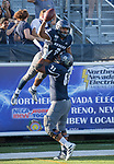 Nevada's running back Jaxson Kincaide (5) is lifted in the air by Aaron Frost (65) after scoring a touchdown in the third quarter of the Nevada vs Weber State football game in Reno, Nevada on Saturday, Sept. 14, 2019.