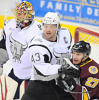 San Antonio Rampage's Nolan Yonkman (43) defends the crease against Chicago Wolves' Antoine Roussel (27) in front of Rampage goaltender Jacob Markstrom during the first period of an AHL hockey game, Wednesday, April 4, 2012, in San Antonio. (Darren Abate/pressphotointl.com)