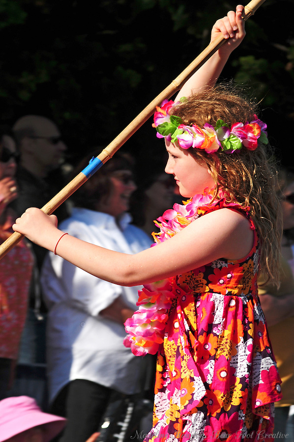 A brightly-dressed girl participates in Olympia, Washington's Procession of the Species.