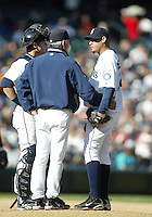 04 October 2009: Seattle Mariners pitching coach Rick Adair talks with starting pitcher Felix Hernadez and catcher Rob Johnson during the game against the Texas Rangers. Seattle won 4-3 over the Texas Rangers at Safeco Field in Seattle, Washington.
