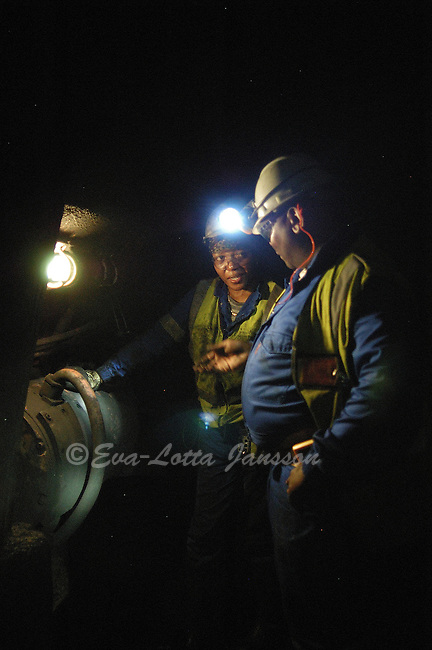 Sophie Moganetsi, 31, a fitter (a worker who maintains the large machines used to mine and haul coal), with her supervisor at Ingwe Collieries? Koornfontein mines, near Witbank. ..