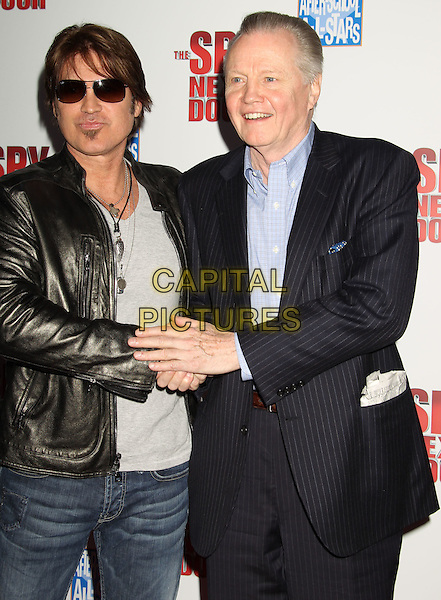 "BILLY RAY CYRUS & JON VOIGHT.""The Spy Next Door"" Los Angeles Premiere held at The Grove, Los Angeles, California, USA, .January 9th, 2010. .half length suit leather jacket sunglasses shades soul patch facial hair holding shaking hands blue shirt black jacket mouth open.CAP/ADM/MJ.©Michael Jade/AdMedia/Capital Pictures."