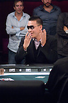 Steve Sung went all in with pocket kings but then reacts as he sees Lehmann with pocket aces.  His  friends in the background, Nam Le, Kirk Morrison and JC Alvarado, react as the cards hit the table.