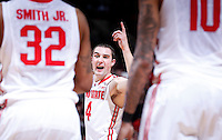Ohio State Buckeyes guard Aaron Craft (4) rallies his team as the head to a timeout during the second half of the NCAA men's basketball game between the Ohio State Buckeyes and the Minnesota Golden Gophers at Value City Arena in Columbus, Ohio, on Saturday, Feb. 22, 2014. The Buckeyes overcame a 10-point deficit at the half to defeat the Minnesota Golden Gophers 64-46. (Columbus Dispatch/Sam Greene)
