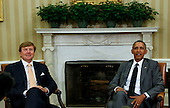 United States President Barack Obama (R) meets with King Willem-Alexander (C) and the Queen Maxima (unseen) of the Netherlands in the Oval Office of the White House in Washington, D.C. on June 1, 2015,  <br /> Credit: Aude Guerrucci / Pool via CNP