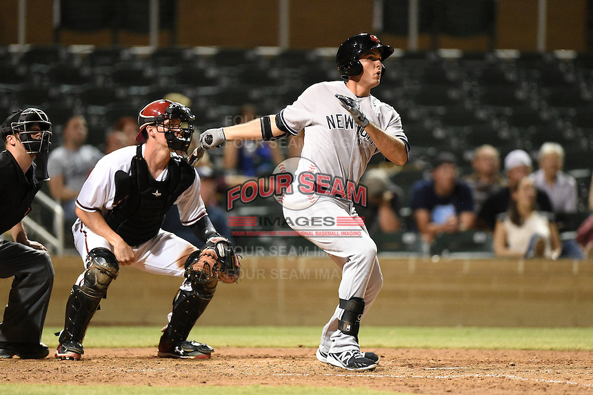Scottsdale Scorpions infielder Greg Bird (20) hits a home run in front of catcher Peter O'Brien during an Arizona Fall League game against the Salt River Rafters on October 7, 2014 at Salt River Fields at Talking Stick in Scottsdale, Arizona.  Scottsdale defeated Salt River 7-4.  (Mike Janes/Four Seam Images)