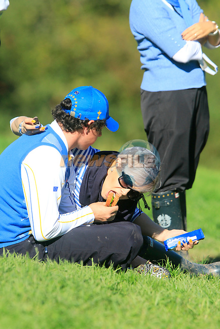 Rory McIlroy and girl Holly Sweeney wait at the 15th green during the Singles Matches during the Final Day of the The 2010 Ryder Cup at the Celtic Manor, Newport, Wales, 3rd October 2010..(Picture Eoin Clarke/www.golffile.ie)