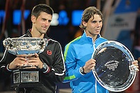 MELBOURNE, 30 JANUARY - Rafael Nadal (ESP) and Novak Djokovic (SRB) pose for pictures with their trophies at the men's finals match on day 14 of the 2012 Australian Open at Melbourne Park, Australia. (Photo Sydney Low / syd-low.com)