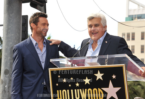 Hugh Jackman & Jay Leno (right) on Hollywood Blvd where Jackman was honored with the 2,487th star on the Hollywood Walk of Fame..December 13, 2012  Los Angeles, CA.Picture: Paul Smith / Featureflash