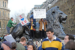 "Protestors climb onto one of the lions at the base of Nelsons Column in Trafalgar Square in London  during the ""Put it to the People"" rally which made it's way through central London today. Demonstrators from across the country gathered to call for a second referendum on Brexit and to march through the UK capital finishing with speeches in Parliament Square opposite the Houses of Parliament in Westminster."