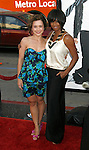"""HOLLYWOOD, CA. - April 14: Olesya Rulin and Monique Coleman arrive at the premiere of Warner Bros. """"17 Again"""" held at Grauman's Chinese Theatre on April 14, 2009 in Hollywood, California."""