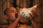 Palau, Micronesia -- Palauan local using a sea shell as a music instrument.