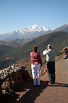 Tourists looking towards snow peak of Jebel Toubkal range from Tiz-n-Tichka road through Atlas Mountains, Morocco, north Africa