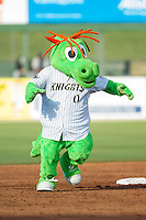 Charlotte Knights mascot Homer the Dragon runs the bases between innings of the South Atlantic League game between the Hickory Crawdads and the Kannapolis Intimidators at CMC-Northeast Stadium on May 18, 2014 in Kannapolis, North Carolina.  The Intimidators defeated the Crawdads 6-5 in 10 innings.  (Brian Westerholt/Four Seam Images)
