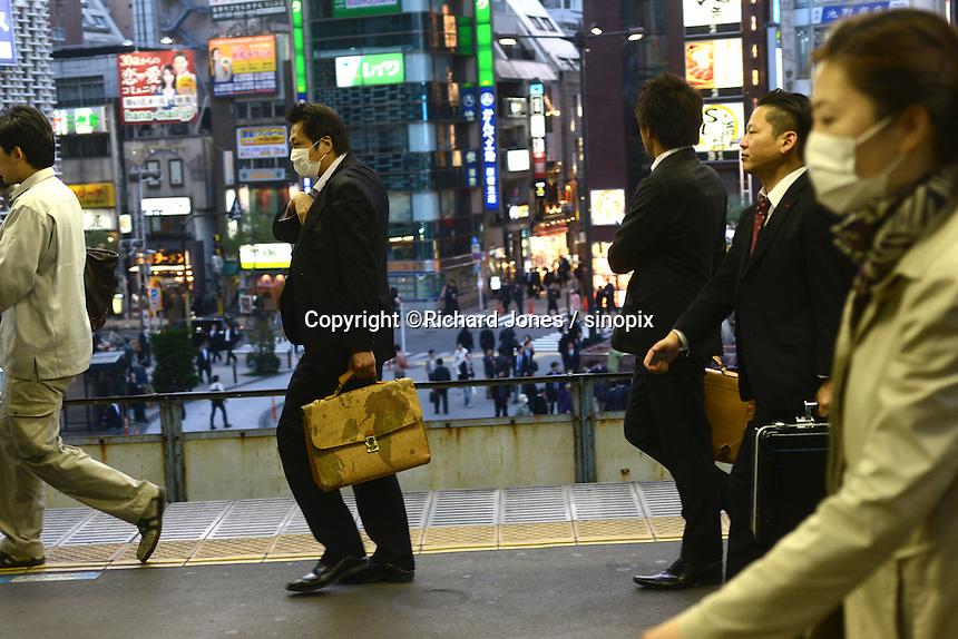 A Japanese businessman Urackacho JR station,  Ginza, Tokyo, Japan.<br /> April-2014