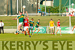 Kerry's corner back David Naughton tries to take possession against Colm Barrett of Cork in the Munster U20 Football final in Austin Stack Park on Friday.