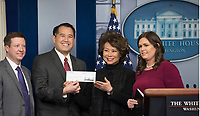 Washington, DC - FEBRUARY 13: Secretary of Transportation Elaine Chao talks about the changes the Trump Administration wants to accomplish during a briefing at the White House. She also showed the $100 Thousand Dollar check that President Donald J Trump gave to the Department of Transportation from his Presidential salary. February 13, 2018. Credit: Patsy Lynch/MediaPunch