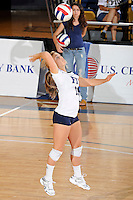 24 September 2010:  FIU's Chanel Araujo (13) serves in the first set as the FIU Golden Panthers defeated the University of Denver Pioneers, 3-0 (29-27, 25-16, 25-20), at U.S Century Bank Arena in Miami, Florida.