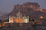 """White marble mausoleum """"Jaswant Thada""""  with Mehrangarh Fort in background, Jodphur, Rajasthan, India --- Model Released"""