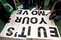 Activists making banner in the conference center. United Nations Climate Change Conference (COP15) was held at Bella Center in Copenhagen from the 7th to the 18th of December, 2009. A great deal of groups tried to voice their opinion and promote their cause in various ways. .©Fredrik Naumann/Felix Features.