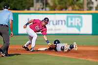 Pensacola Blue Wahoos shortstop Jordan Gore (10) tags Jahmai Jones (15) sliding into second base during a Southern League game against the Mobile BayBears on July 25, 2019 at Blue Wahoos Stadium in Pensacola, Florida.  Pensacola defeated Mobile 2-1 in the first game of a doubleheader.  (Mike Janes/Four Seam Images)