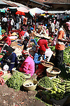 Women selling beans and salad at the Analakely market in Antananarivo in Madagascar