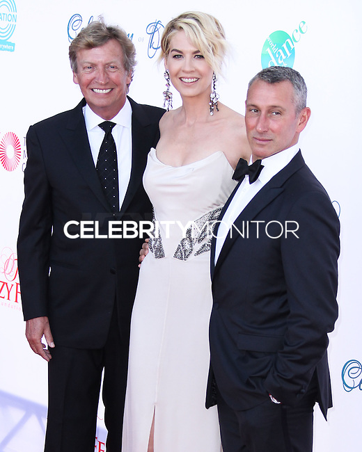 LOS ANGELES, CA, USA - JULY 19: Nigel Lythgoe, Jenna Elfman, Adam Shankman at the 4th Annual Celebration Of Dance Gala Presented By The Dizzy Feet Foundation held at the Dorothy Chandler Pavilion at The Music Center on July 19, 2014 in Los Angeles, California, United States. (Photo by Xavier Collin/Celebrity Monitor)