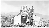 West end of snowshed as reconstructed, crew standing on roof beam.<br /> D&amp;RG  Cumbres, CO  Taken by Lively, Charles R. - 2/1916
