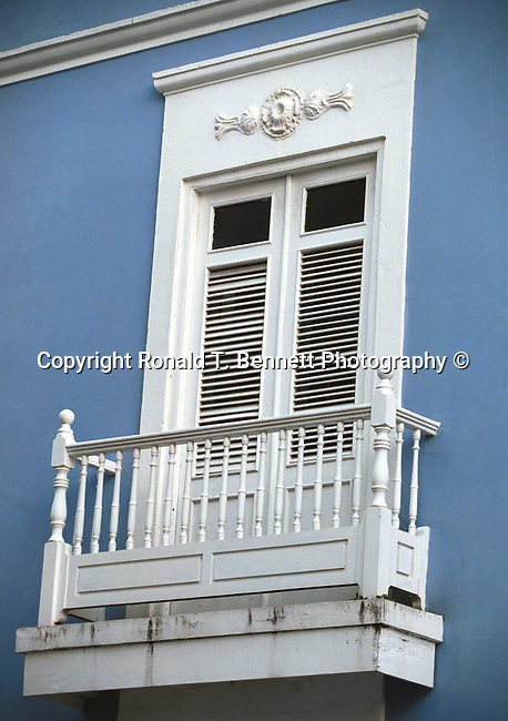 Window with white shutters and blue background San Juan Puerto Rico, Commonwealth of Puerto Rico, Estado Libre Asociado de Puerto Rico, self governing unincorporated territory of the United States, archipelago, main island of Puerto Rico, Vieques, Culebra, Mona, four Greater Antilles, Borinquen,  Taino, Boricua, borincano, Boriken, Borinquen, la Isla del Encanto, The Island of Enchantment, Christopher Columbus, Spanish, First settlers were Ortoiroid people, Archaic Period culture of Amerindian hunters and fishermen, Igneri, Taino culture, Spanish colony, Arawak Indian, Garita at fort San Felipe del Morro, United States colony, San Felipe del Morro,, San Cristobal Fortresses, La Fortaleza, Santa Catalina Place, Fine art and stock photography by Ronald T. Bennett Photography ©, RonBennettPhotography.com, RonBennettPhotography.net,The Islands of Enchantment Fine Art Photography by Ron Bennett, Fine Art, Fine Art photography, Art Photography, Copyright RonBennettPhotography.com ©