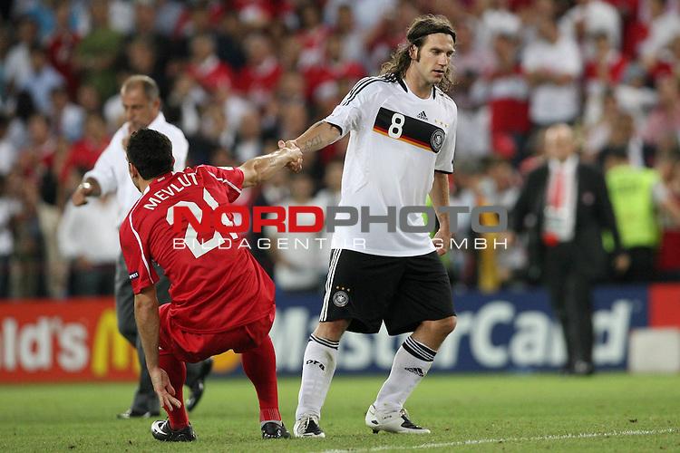 UEFA Euro 2008 Semi-Finals Match 29 Basel - St. Jakob-Park. Deutschland ( GER ) - T&uuml;rkei ( TUR ) 3:2 ( 1:1 ). <br /> Torsten Frings ( Germany / Mittelfeldspieler / Midfielder / Werder Bremen #08 ) (r) hilft Mevlut Erdinc ( T&uuml;rkei / Angreifer / Forward / FC Sochaux #21 ) (l) hoch bei Spielende.<br /> Foto &copy; nph (  nordphoto  )