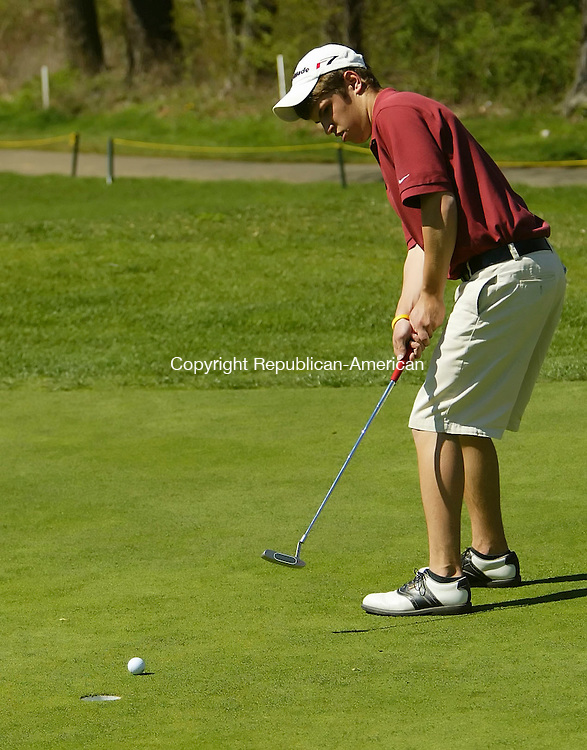 NAUGATUCK, CT 5/03/07- 050307BZ11-  Naugatuck's Andrew Plude makes a putt on the third hole during a match against Watertown at Hop Brook Golf Course in Naugatuck Thursday.<br /> Jamison C. Bazinet Republican-American
