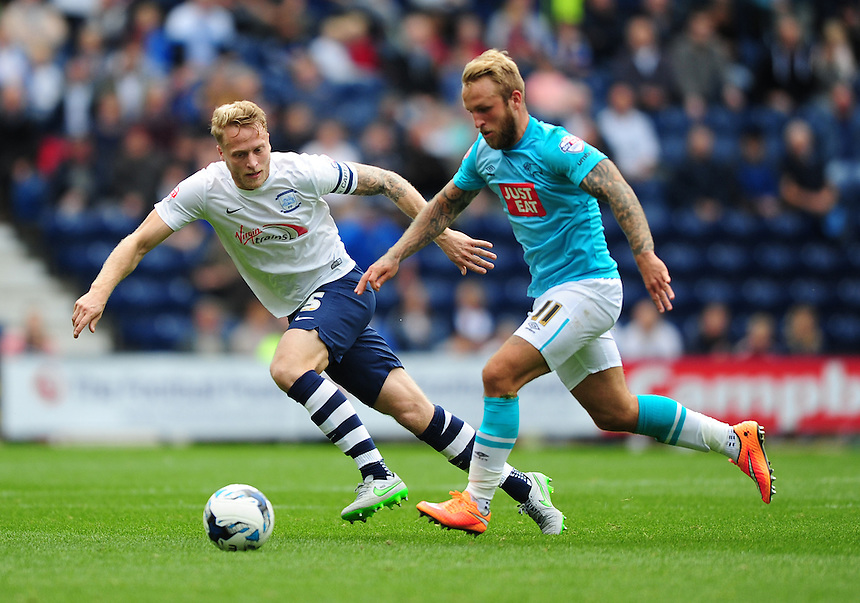 Preston North End's Tom Clarke vies for possession with Derby County's Johnny Russell<br /> <br /> Photographer Chris Vaughan/CameraSport<br /> <br /> Football - The Football League Sky Bet Championship - Preston North End v Derby County - Saturday 12th September 2015 -  Deepdale - Preston<br /> <br /> &copy; CameraSport - 43 Linden Ave. Countesthorpe. Leicester. England. LE8 5PG - Tel: +44 (0) 116 277 4147 - admin@camerasport.com - www.camerasport.com