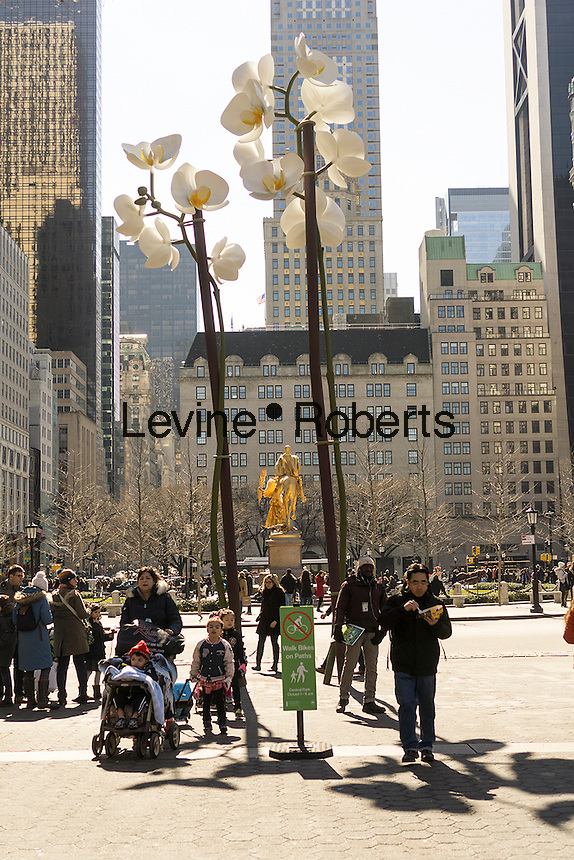 """Isa Genzken's """"Two Orchids"""" are a harbinger of spring during its exhibit in the Doris C. Freedman Plaza of Central Park in New York on Sunday, March 6, 2016.  The 28 and 34 foot tall sculpture is constructed of stainless steel. The exhibition is sponsored by the Public Art Fund and will be on view until August 21, 2016.  (© Richard B. Levine)"""