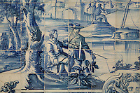 Men fishing, from scenes of the history of the monastery and the Siege of Lisbon in 1147, traditional blue and white azulejos tile scene, 18th century, in the Monastery of Sao Vicente de Fora, an Augustinian order monastery and church built in the 17th century in Mannerist style, Lisbon, Portugal. The monastery also contains the royal pantheon of the Braganza monarchs of Portugal. Picture by Manuel Cohen