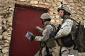 U.S. Marines from India Company, 3rd Battalion, 3rd Marine Regiment prepare to enter a house in Haditha, Iraq, Aug. 8, 2006. (U.S. Marine Corps photo by Cpl. Brian M. Henner) (Released)