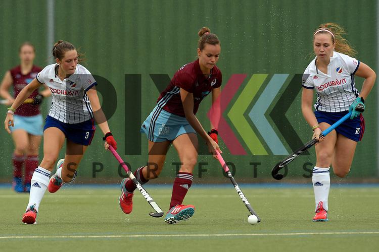 GER - Mannheim, Germany, September 18: During the women hockey match between Mannheimer HC (white) and UHC Hamburg (purple) on September 18, 2016 at Mannheimer HC in Mannheim, Germany. Final score 3-2 (HT 2-1).  (L-R) Cecile Pieper #3 of Mannheimer HC, Jana Teschke #4 of Uhlenhorster HC Hamburg, Nike Lorenz #16 of Mannheimer HC<br /> <br /> Foto &copy; PIX-Sportfotos *** Foto ist honorarpflichtig! *** Auf Anfrage in hoeherer Qualitaet/Aufloesung. Belegexemplar erbeten. Veroeffentlichung ausschliesslich fuer journalistisch-publizistische Zwecke. For editorial use only.