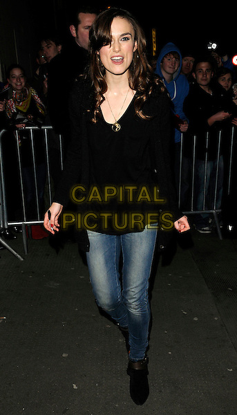 "KEIRA KNIGHTLEY .Leaving after the evening performance of ""The Misanthrope"" Comedy Theatre, London, England, UK, .January 30th 2010..Departures full length black cardigan jeans boots ankle skinny gold necklace mouth open funny .CAP/CAN.©Can Nguyen/Capital Pictures"