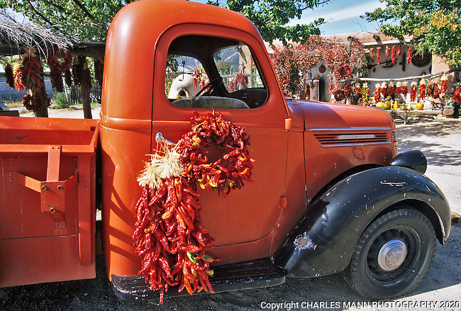 In September and October, a red pickup truck is the perfect foil for colorful red chile ristras at a fruit stand near the village of Velarde in northern New Mexico.