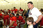 Ole Miss head coach Ed Orgeron smiles with his team as he is greeted by hundreds of UM students that came to Wednesday night's spring practice session to catch a glimpse of the Ole Miss Rebels.  The practice was open to the students, who were treated to a pep talk by Coach Orgeron, as well as autographs and photos. Photo by Nathan Latil/Ole Miss Communications