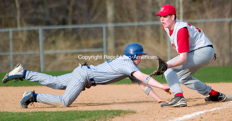 BURLINGTON, CT- 23 APRIL 07- 042307JT07-<br /> Lewis Mills' Cody Santore slides safely back to first as Wamogo's Craig Potter covers the bag during Monday's game at Lewis Mills.<br /> Josalee Thrift Republican-American