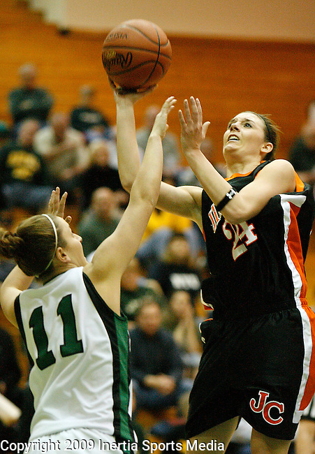 SPEARFISH, SD - FEBRUARY 25, 2009 --  Ali Edwards  #24 of Jamestown College shoots over Black Hills State defender Keely Krolikowski #11 during their Dakota Athletic Conference semi-final game Wednesday evening at the Young Center.  (Photo by Dick Carlson/Inertia)
